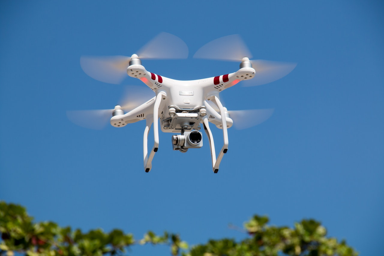 drone-flying-against-blue-sky-336232
